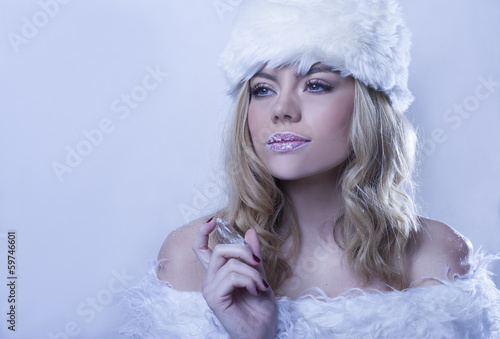 Beautitul woman in white winter fur