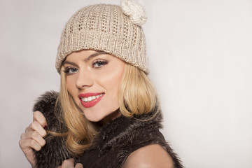 Attractive blond in a winter jacket and beanie