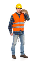 Construction worker in reflective clothing and holding rope.