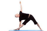 Energetic middle-aged man doing yoga poses