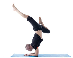 Flexible man posing in difficult yoga pose