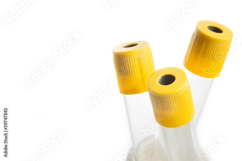 Leinwandbild Motiv detail of test tubes in laboratory on white background