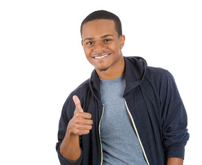 Happy young smiling man giving thumbs up