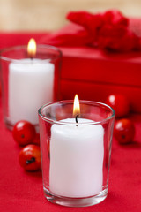 White candle in glass candle holder