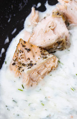 Salmon in dill sauce, closeup, selective focus