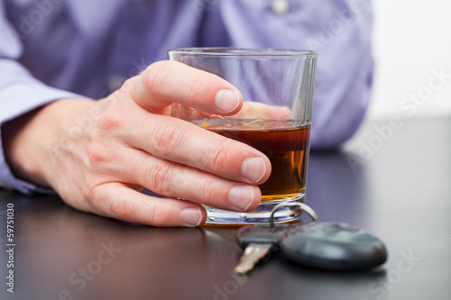 Driver with glass of whisky