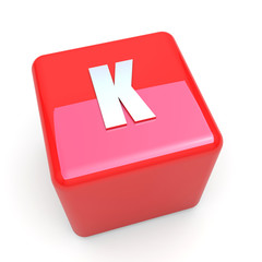 K vitamin symbol on glossy red cube