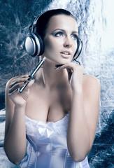 Portrait of a beautiful woman smoking an electronic cigarette