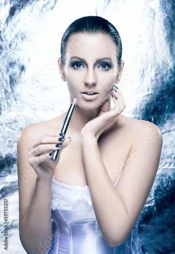 Glamour portrait of young woman smoking an e-cigarette