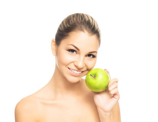 Portrait of a beautiful and happy woman holding a fresh apple