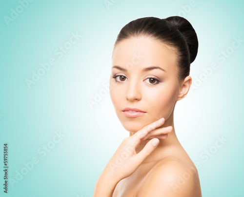 Portrait of a healthy woman in spa style on a light background