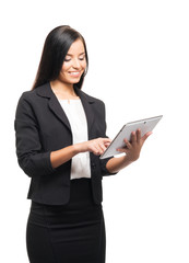 A young businesswoman in formal clothes holding a tablet