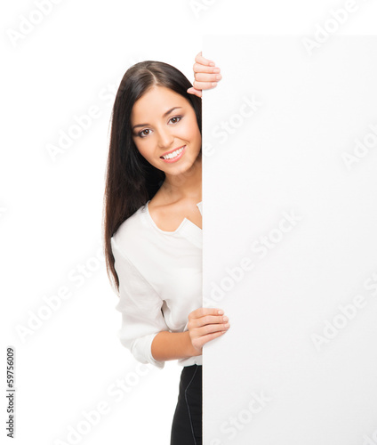 A young brunette businesswoman holding a blank white banner
