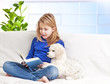 A girl reading a book little puppies