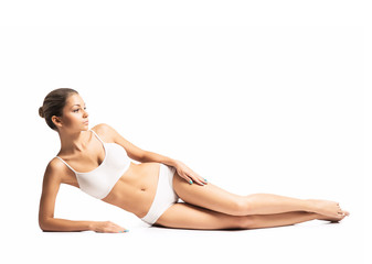 A fit girl in lingerie isolated on a white background