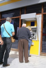 People queue to use an ATM, cash machine