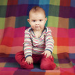 Cute serious boy portrait on colorful background