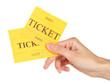 Woman's hand holding a colorful tickets