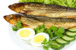 Smoked fish on plate close up