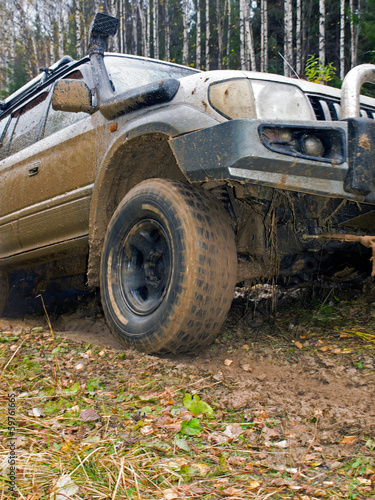 Off-road vehicle with a broken bumper stuck in a swamp. Urals. R