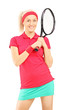 Young smiling female posing with a tennis racket