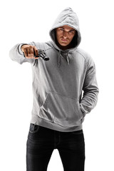 Young male with hood over his head with a gun, symbolizing crime