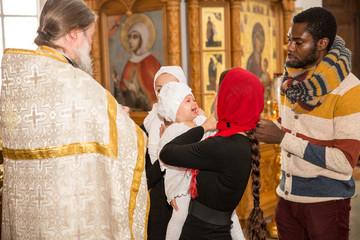 Family celebrating  baptism in Orthodox Church