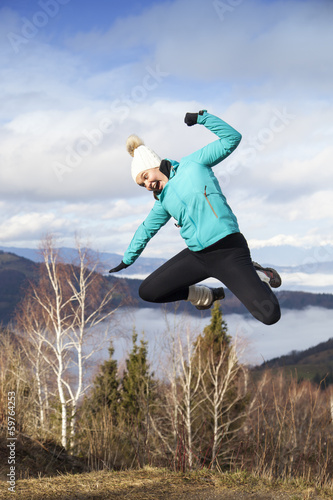 Young women joyfully jumping outdoors