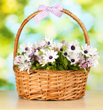 bouquet of beautiful summer flowers in basket,