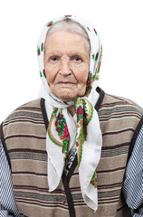 Portrait of a senior woman in headscarf looking at the camera