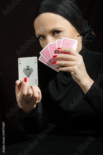 Woman in black playing cards