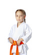Very serious little girl in a kimono with orange belt