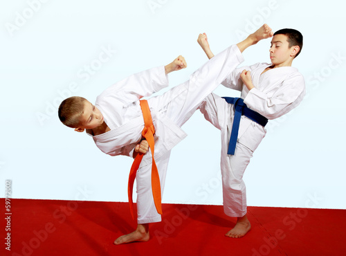 Two athletes doing sports paired exercises