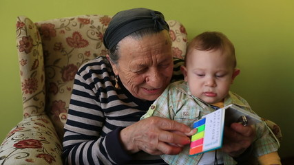 grandmother teaching to grandson