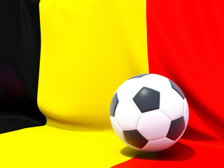Flag of belgium with football in front of it