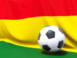 Flag of bolivia with football in front of it