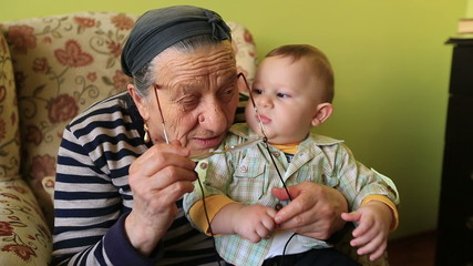 grandmother playing to grandson