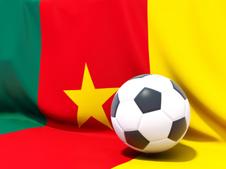 Flag of cameroon with football in front of it