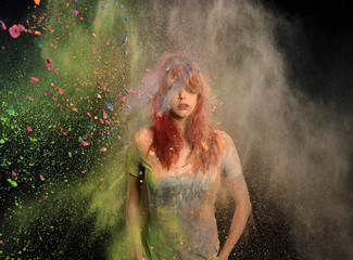 Girl with Colored Powder Exploding Around Her