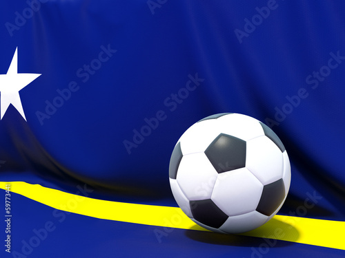 Flag of curacao with football in front of it