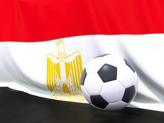 Flag of egypt with football in front of it