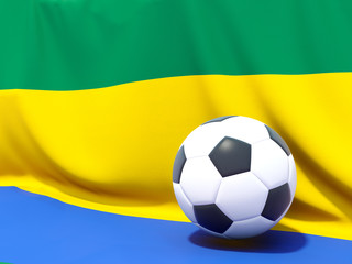 Flag of gabon with football in front of it