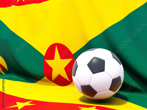 Flag of grenada with football in front of it