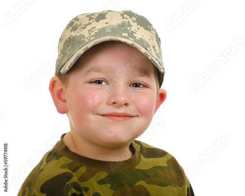 Smiling happy boy wearing camo hat and shirt