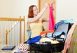 woman choosing clothes for vacation  at home