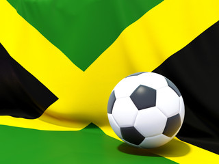 Flag of jamaica with football in front of it