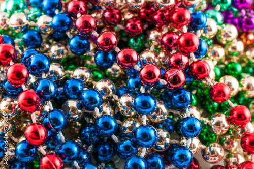 Mardi gras beads isolated on white.