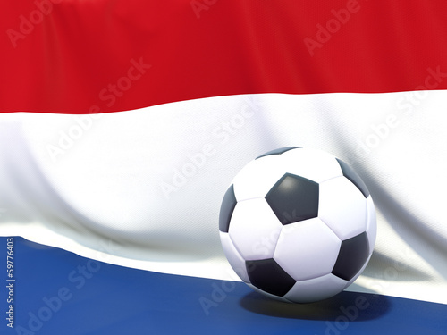 Flag of netherlands with football in front of it