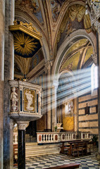 Sunbeams on pulpit, village church interior- Corniglia, Cinque