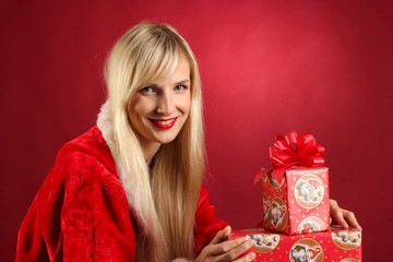 beautiful woman with christmas present